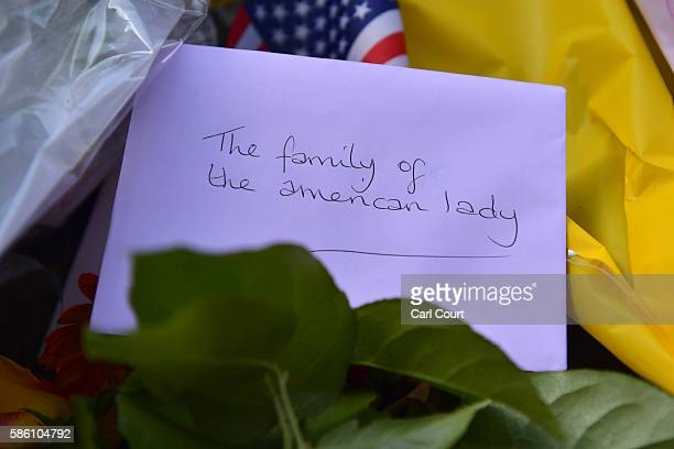 A card is left with flowers at the scene of a stabbing in which one woman was murdered on August 5 2016 in London England Darlene Horton a 64yearold...