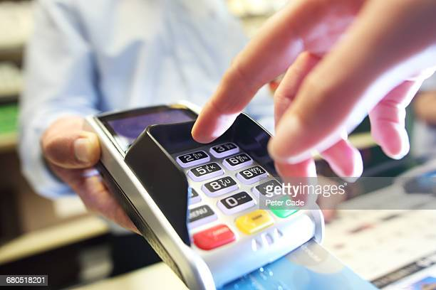 card machine being used in shop - credit card reader stock pictures, royalty-free photos & images
