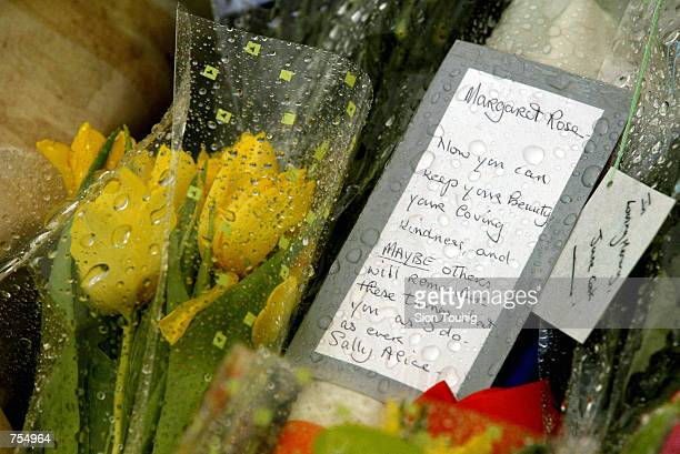 A card on a bouquet are left at Kensington Palace February 11 2002 after the death of Princess Margaret in London Unlike the death of the Princess of...