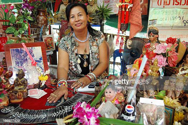 A card reader surrounded with images of spirits ghosts and other paraphernalia Wat Mahabut a Buddhist temple known for the shrine of the legendary...