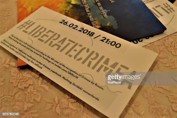 A card reading the hashtag of 'Liberate Crimea' is displayed on a table during a proUkrainian protest against Russia on the 4th anniversary of the...