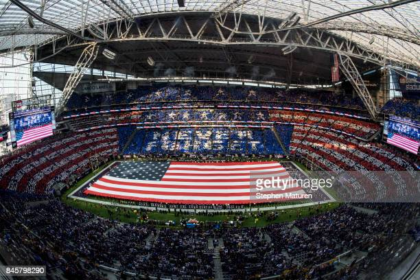 A card stunt displays NEVER FORGET while the National Anthem plays before the game between the Minnesota Vikings and New Orleans Saints on September...