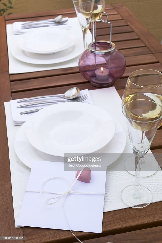 Card with heart on place setting, elevated view : Stock Photo