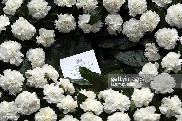 A card with message to those who lost their lives appears on the wreath laid by British consul general Barbara Hay on the explosion site of last...