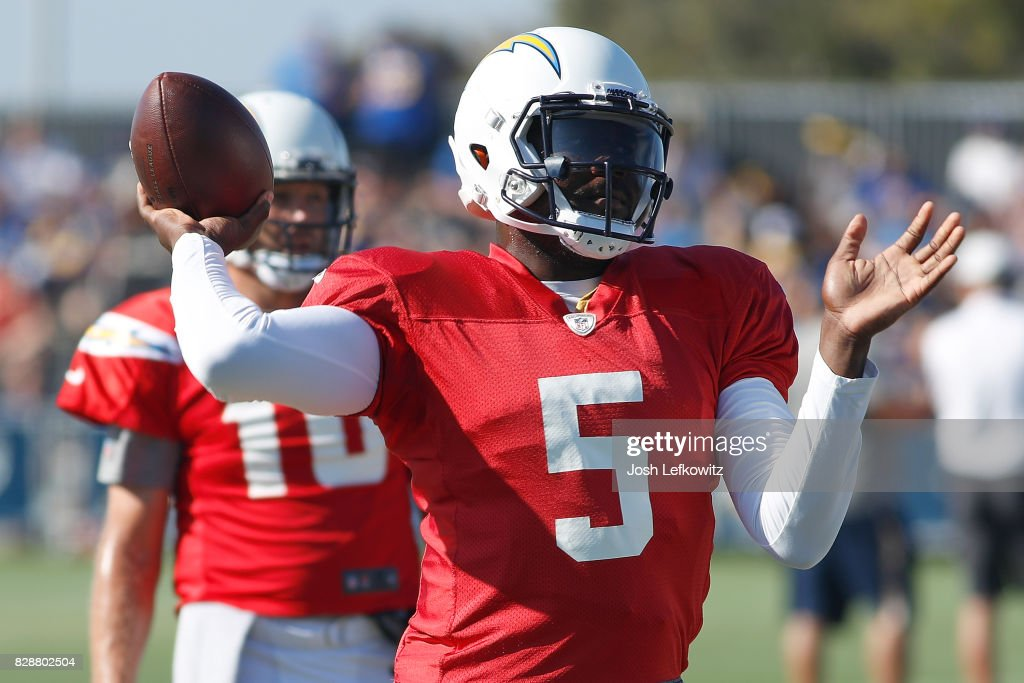 Cardale Jones #5 of the Los Angeles Chargers throws a pass during a combined practice with the Los Angeles Rams at Crawford Field on August 9, 2017 in Irvine, California.