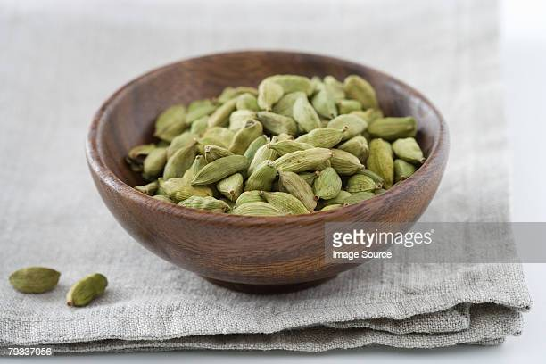 cardamom seeds in a bowl - cardamom stock photos and pictures
