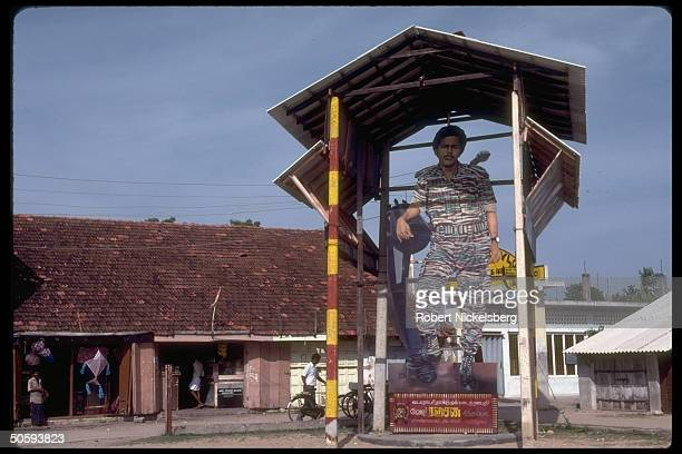 Cardbd cutoutlike statue of secessionist LTTE Tamil Tiger guerrilla fighter dominating scene Point Pedro Jaffna peninsula Sri Lanka