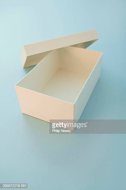 Cardboard box and cover on blue background