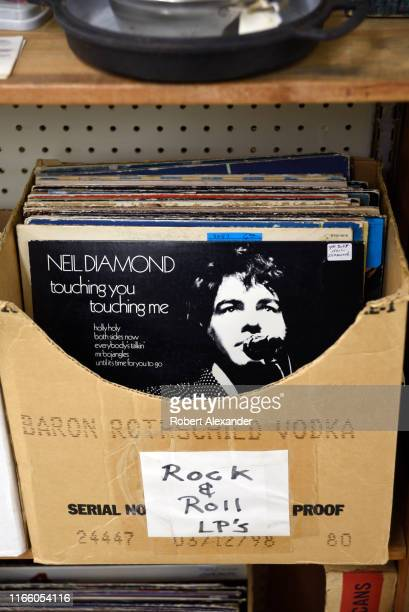 Cardboard box in an antiques and collectibles shop in Newport, Oregon, holds a selection of used record albums for sale including a Neil Diamond...