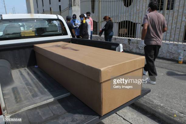 A cardboard box is used as a coffin as it is being transported on a van to Jardines de la Esperanza Cemetery on April 7 2020 in Guayaquil Ecuador...