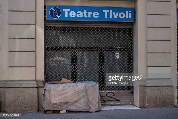 Cardboard box of a homeless person at the main door of the Tivoli Theater in Barcelona closed to the public due to the Covid 19 crisis. After the...