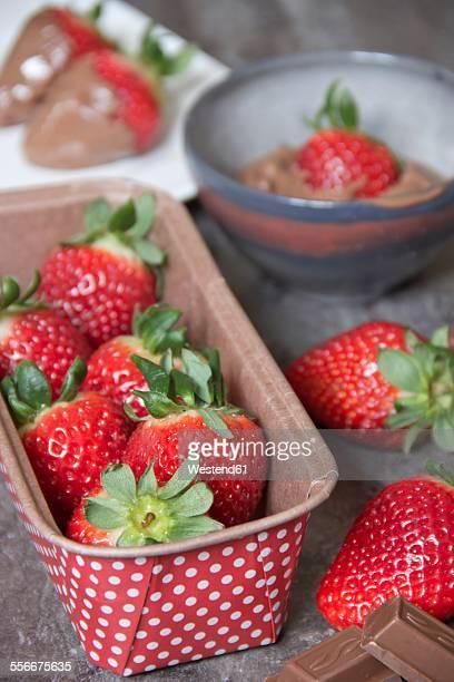Cardboard box of fresh strawberries and chocolate coated strawberries