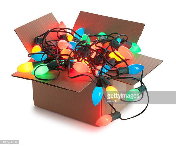 Cardboard Box Of String of Tangled Illuminated Christmas Lights Isolated