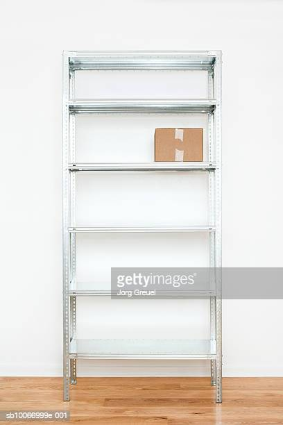 Cardboard box on steel shelf