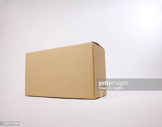 cardboard box on white background - cardboard box stock pictures, royalty-free photos & images