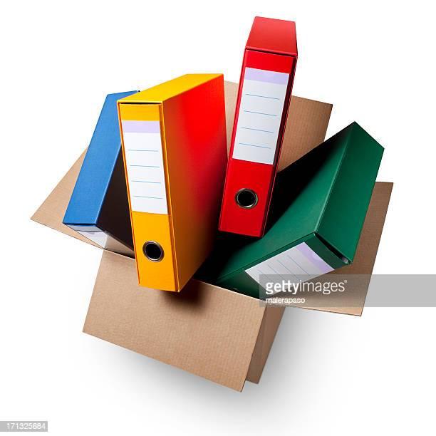 Cardboard box with ring binders.