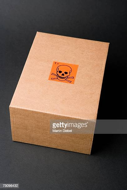 Cardboard box with toxic label
