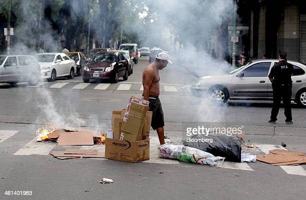Cardboard boxes are burned on a street in protest in the Villa Crespo neighborhood of Buenos Aires Argentina on Tuesday Jan 7 2014 Empresa...