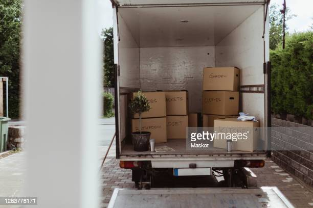 cardboard boxes arranged in back of moving truck - removal stock pictures, royalty-free photos & images