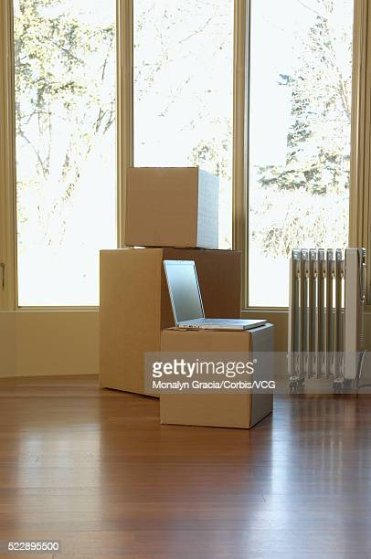 Cardboard boxes in an empty room