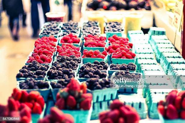 Cardboard Boxes Of Blueberries And Raspberries For Sale