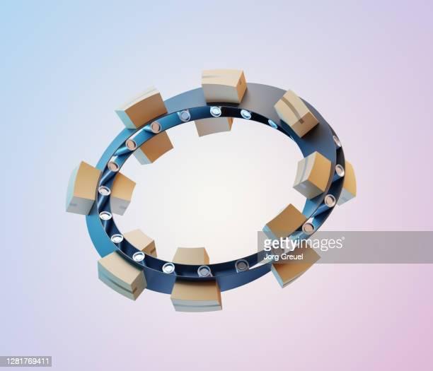 Cardboard boxes on a Moebius strip-shaped conveyor belt