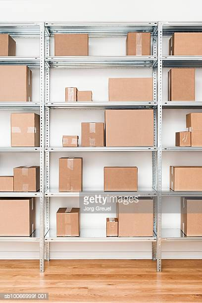 Cardboard boxes on steel shelf