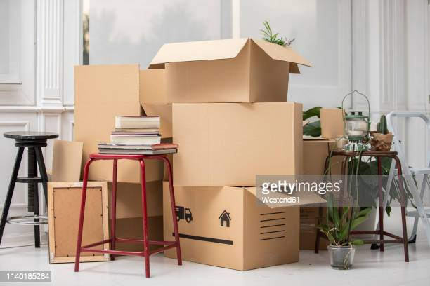 cardboard boxes on the floor in new home - 引っ越し ストックフォトと画像