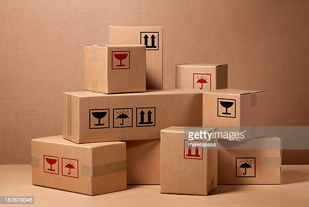 cardboard boxes - carton stock pictures, royalty-free photos & images
