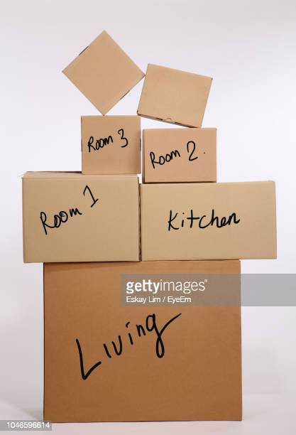 Cardboard Boxes Stacked Against White Background