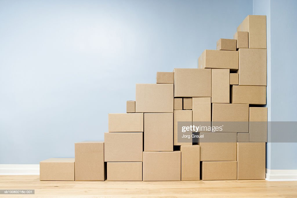 Cardboard boxes stacked one on another in shape of stairs : Stock Photo
