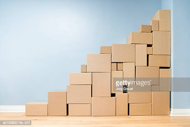 cardboard boxes stacked one on another in shape of stairs - cardboard box stock pictures, royalty-free photos & images