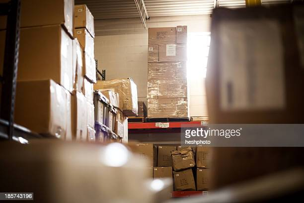 cardboard boxes stored in warehouse - heshphoto stock pictures, royalty-free photos & images