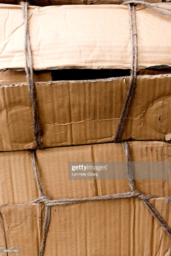 Cardboard boxes tied up with string : Stock Photo