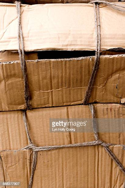 cardboard boxes tied up with string - lyn holly coorg stock pictures, royalty-free photos & images