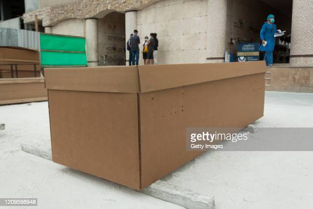 A cardboard coffin with a body lies on the floor at Jardines de la Esperanza cemetery on April 10 2020 in Pascuales Guayaquil Ecuador Guayas Province...