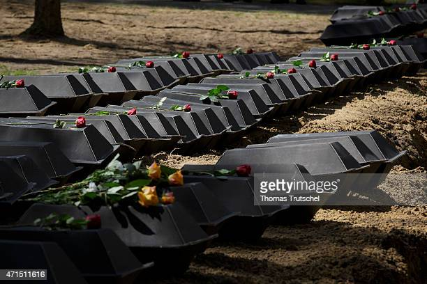 Cardboard coffins containing the remains of World War II German war dead about to be interred into a mass grave prior to a ceremony held by the...