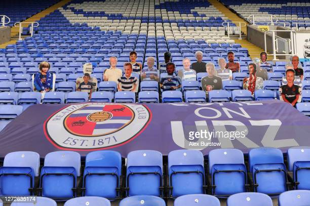 Cardboard cut fans are seen behind a Reading FC flag inside the stadium prior to Carabao Cup Second Round match between Reading FC and Luton Town at...