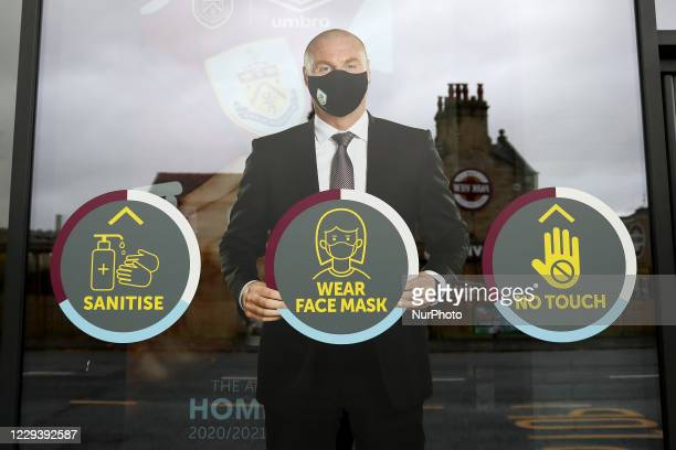 A cardboard cut out of Burnley manager Sean Dyche is seen in the club shop informing people of COVID correct actions during the Premier League match...