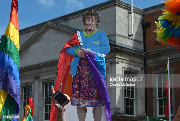 A cardboard cut out of popular Irish television character Mrs Brown is held high as supporters in favour of samesex marriage gather in Dublin Castle...