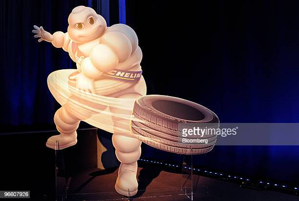 A cardboard cut out of the 'Michelin Man' sits on stage at a news conference in Paris France on Friday Feb 12 2010 Michelin Cie the world's...