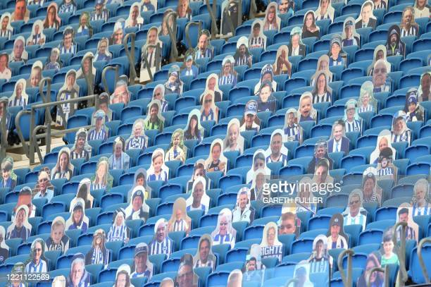 Cardboard cut out photograph of Brighton supporters are seen in the upper tier of the stand ahead the English Premier League football match between...