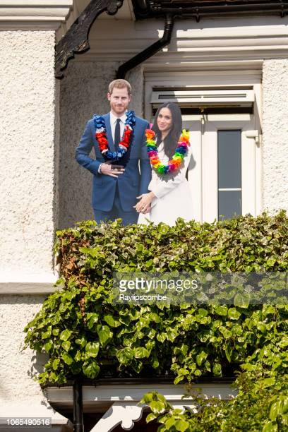 cardboard cut outs of meghan markl and prince harry on a house front in windsor celebrating the marriage of meghan markle and prince harry at st george's chapel at windsor castle - meghan stock photos and pictures