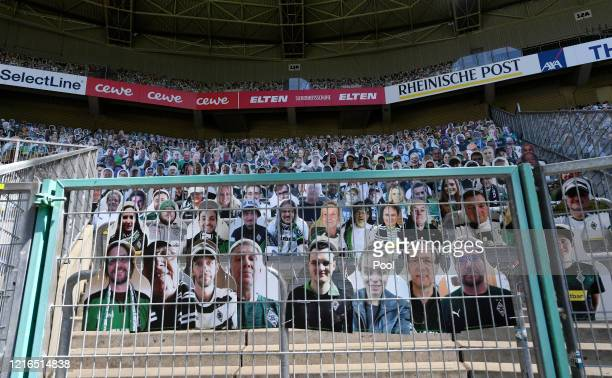 Cardboard cut outs with photos of Moenchengladbach fans are displayed in the empty stands prior to the Bundesliga match between Borussia...