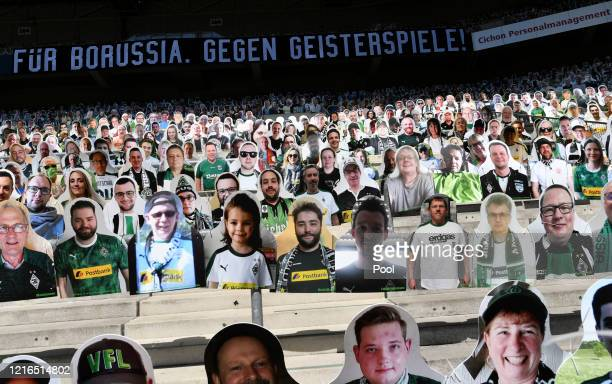 Cardboard cut outs with photos of Moenchengladbach fans displayed on the stands ahead of the Bundesliga match between Borussia Moenchengladbach and...