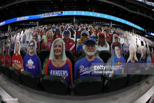 Cardboard cut-out images of fans are seen in the stands before a game between the Colorado Rockies and the Texas Rangers on Opening Day at Globe Life...