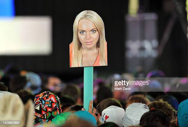 Cardboard cutout of actress Lindsay Lohan is seen in the audience during the Breakbot performance in the Sahara Tent at Day 1 of the 2012 Coachella...