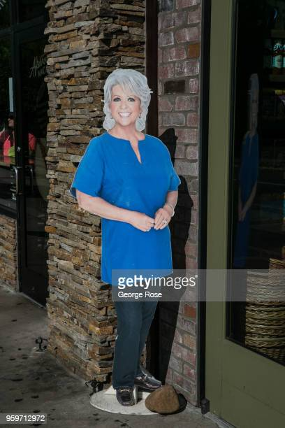 A cardboard cutout of culinary celebrity Paula Deen greets visitors to her store on May 11 2018 in Gatlinburg Tennessee Situated near the entrance to...