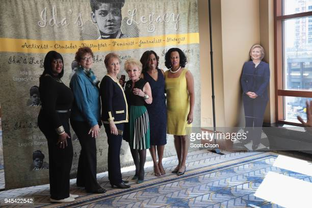 A cardboard cutout of Former Secretary of State Hillary Clinton sits in the corner as guests pose for pictures at the Idas Legacy Fundraiser Luncheon...