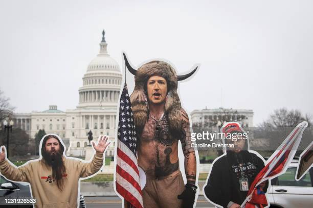 March 25: A cardboard cutout of Mark Zuckerberg, CEO of Facebook, dressed up as the QAnon Shaman, along with other cutouts of people involved in the...